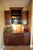 Thumb misc  shaker style  knotty alder  dark color  recessed panel  dry bar  open bookcase  open shelves  staggered   13 crown  standard overlay