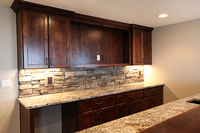 Thumb misc  traditional style  knotty alder  dark color  recessed panel  wet bar entertainment area  opening for tv  standard overlay   28 crown