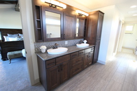 Thumb vanity  contemporary style  clear alder  dark color  recessed panel  open cubbies  medicine cabinet  linen  double sinks  master bath  full overlay