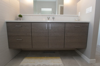 Thumb vanity  contemporary style  custom laminate  grey color  banded door  floating  frameless construction  3