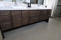 Thumb vanity  contemporary style  quartersawn walnut  dark color  banded door  floating look  legs  banks of drawers  full overlay