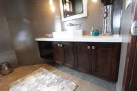 Thumb vanity  contemporary style  western maple  dark color  open bookcase  cubbies  single sink  off center sink  full overlay