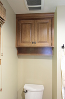 Thumb vanity  craftsman style  quartersawn oak  medium color  raised panel  toilet topper   13 crown  standard overlay