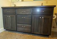 Thumb vanity  shaker style  hickory  grey color  recessed panel  wood countertop edge  bank of 3 drawers  standard overlay