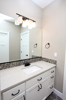 Thumb vanity  traditional style  painted  recessed panel  single sink  bank of drawers  full overlay