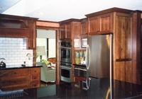 Thumb kitchen  traditional style  rustic maple  dark color  recessed panel doors and ends  angled wood hood   6 standard crown  standard overlay