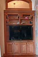 Thumb great room  traditional style  western maple  medium color  raised panel  open bookcase  tv space  flutes  entertainment center  built ins  onlays  standard overlay
