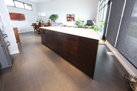 Thumb kitchen  contemporary style  quartersawn walnut  dark color  banded door  angled island  frameless style