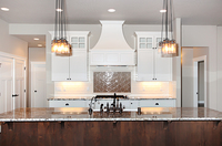 Thumb kitchen  craftsman style  painted  recessed panel  glass grid doors on top  wood hood  accent color island  standard overlay