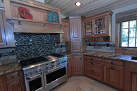 Thumb kitchen  craftsman style  quartersawn oak  medium color  flush mount  glass grid  wood hood  appliance garage  diagonal corner cabinets  cup rack