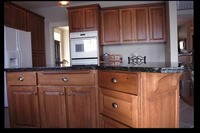 Thumb kitchen  craftsman style  quartersawn oak  medium color  raised panel  bread board  standard bar supports  standard overlay