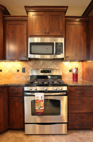 Thumb kitchen  shaker style  knotty alder  dark color  recessed panel  staggered heights  micro hood   13 overlay  standard overlay