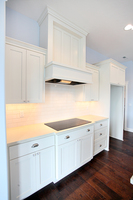 Thumb kitchen  shaker style  painted  wainscot and recessed panel  wood hood  staggered heights  5 piece fronts  full overlay