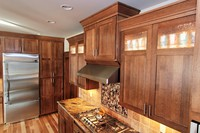 Thumb kitchen  shaker style  quartersawn oak  recessed panel  dark color  glass top panel  rain glass  staggered heights  angled bottom on range hood cabinet  full overlay