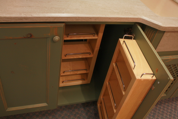 Bigthumb kitchen  traditional style  knotty alder  green paint with sand through and distress  recessed panel doors  chefs pantry shelves  baking center