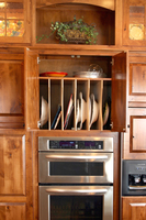 Thumb kitchen  traditional style  knotty alder  medium color  raised panel  flush mount  tray dividers  open with arch