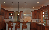 Thumb kitchen  traditional style  western maple  cherry color perimeter  raised panel  accent painted island   custom wood  island overhang  valance  glass doors  flutes  legs  posts  micro in upper  standard overlay